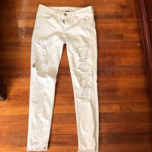American Eagle Cream colored ripped jeggings